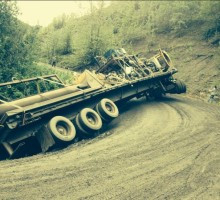 A low bed truck slips off the road at 10 Mile